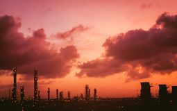 Petrochemical plant. View silhouette on sky sunrise, View of the petrochemical industry while sunset Royalty Free Stock Photo