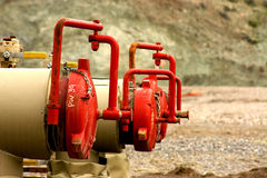 Petrochemical Plumbing. Petrochemical pipe fittings and valves at a storage facility Stock Photos