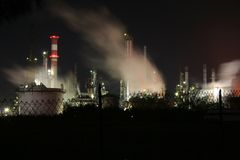 Petrochemical Refinery. Panorama of an industrial area in Rome (Italy) / Petrochemical Refinery / Gasoline Production / Smoke, smog and pollution released by Royalty Free Stock Photography