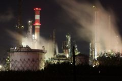 Petrochemical Refinery. Panorama scene of an industrial area in Rome (Italy) / Petrochemical Refinery / Gasoline Production / Smoke, smog and pollution released Royalty Free Stock Image