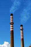 Petrochemical refinery chimneys, Andalusia, Spain. Stock Photos