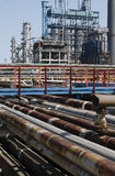 Petrochemical refinery pipes. Industrial view of oil petrochemical refinery pipes Stock Image