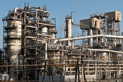Petrochemical Refinery Plant. A petrochemical refinery plant with pipes and cooling towers Royalty Free Stock Photo