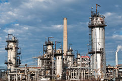 Petrochemical Refinery Plant. A petrochemical refinery plant with pipes and cooling towers Stock Photos