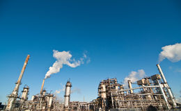 Petrochemical Refinery Plant. A petrochemical refinery plant with pipes and cooling towers Stock Images
