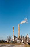 Petrochemical Refinery Plant. A petrochemical refinery plant with pipes and cooling towers Stock Photography