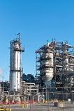 Petrochemical Refinery Plant. A petrochemical refinery plant with pipes and cooling towers Royalty Free Stock Image