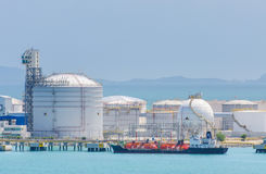 Petrochemical tank farm and jetty. Gas-carrier at petrochemical tank farm and jetty Stock Photos