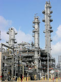Petrochemical Unit. A petrochemical unit in operation with columns and piping against a blue sky Royalty Free Stock Photo