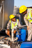 Petrochemical wokers inspecting. Two petrochemical workers inspecting pressure valves on a fuel tank Stock Images