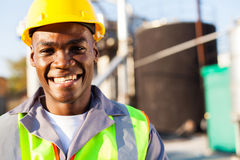 Petrochemical worker portrait. Close up portrait of african american petrochemical worker outside the factory Royalty Free Stock Image