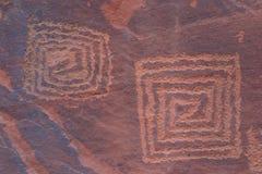 Petroglifi di V-V Fotografie Stock