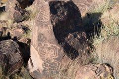 Petroglifi sulla pietra Immagini Stock