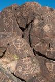 Petroglifi sulla pietra Immagine Stock