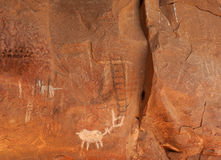 Petroglyph. S. National Forest  site in AZ,USA. Rock Art in Red Rock country near Sedona AZ,USA. Ancient Indian signs and ruins.  s on red rocks.  White rock art Royalty Free Stock Photo