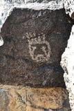 Petroglyph av en indian Royaltyfria Bilder
