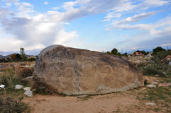 Petroglyph on the big stone Stock Images