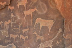 Petroglyph Cave Drawings. Modern petroglyth style cave drawings of various animals Royalty Free Stock Images