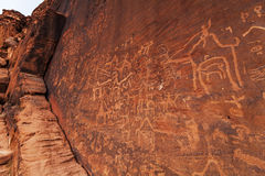 Petroglyph figures in stone walls, Wadi Rum. Stock Photo