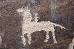 Petroglyph horse rider Stock Photos