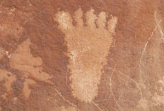Petroglyph of a human foot from Atlati Rock, NV Royalty Free Stock Photos
