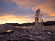 Petroglyph from ice in the light of autumn sunset Stock Photo
