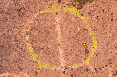 Petroglyph With Lichen. Circular Native American Petroglyph or rock carving with green lichen Stock Image