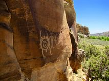 Petroglyph panel at McConkie Ranch near Vernal, Utah. One of the many Fremont Culture petroglyph and pictograph  panels on the cliffside trail at McConkie Ranch Royalty Free Stock Photo