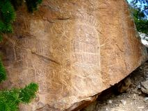 Native American Petroglyph Rock Man. Petroglyph rock carvings of a native american man (or alien?) located in rural country (only the locals know royalty free stock photos
