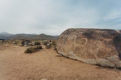 Petroglyphen auf Steinen Stockbild