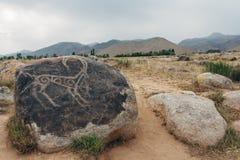 Petroglyphen auf Steinen Lizenzfreies Stockfoto
