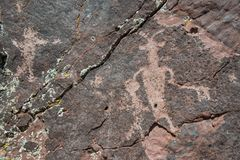 Petroglyphs are ancient rock drawings at Irish Canyon in Colorado. Mysterious petroglyph drawings carved into rocks by ancient Anasazi Fremont people in Irish royalty free stock image