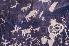 Petroglyphs of animals and hunters Royalty Free Stock Image