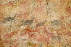 Petroglyphs on a cave wall Royalty Free Stock Images