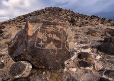 Petroglyphs on the mountain Stock Image