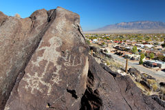 Petroglyphs, Petroglyph National Monument, Albuquerque, New Mexico. Petroglyphs and nearby housing development at Boca Negra, Petroglyph National Monument royalty free stock photos