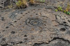 Petroglyphs in lava rock at Pu`uloa along Chain of Craters road, in volcano National Park on the island of Hawaii. Carvings are 40. Petroglyphs at Pu`uloa Long royalty free stock photography