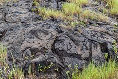 Petroglyphs in lava rock at Pu`uloa along Chain of Craters road, in volcano National Park on the island of Hawaii. Carvings are 40. Petroglyphs at Pu`uloa Long stock photography