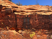 Petroglyphs on the rock canyon wall in Snow Canyon State Park in Utah Royalty Free Stock Photos