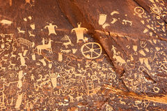 Petroglyphs or rock carving on Newspaper Rock, Utah, USA. Newspaper Rock is a petroglyph panel etched on a sandstone wall in southeastern Utah near Canyonlands Royalty Free Stock Photos
