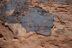 Petroglyphs (Rock Carvings). Ancient rock carvings found in Valley of Fire, Nevada Royalty Free Stock Photo
