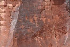 Petroglyphs. On a rock wall face along the Potash-Lower Colorado River Scenic Byway (U-279) near Moab, Utah, USA Stock Photo