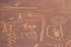 Petroglyphs of stick figures and spiral from Atlati Rock, NV Stock Photos