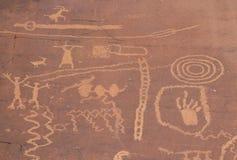 Petroglyphs of stick figures and spiral from Atlati Rock, NV Stock Photos