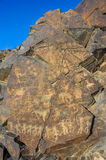 Petroglyphs on the stone Royalty Free Stock Photography