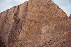Petroglyphs on the stone in Tamgaly, Kazakhstan stock photography