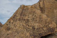 Petroglyphs on the stone in Tamgaly, Kazakhstan Stock Images
