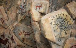 Petroglyphs of tamgala 19 century BC. The historical petroglyphs drawings of petroglyphs of the 19th century BC are painted. found in the territory of royalty free stock image