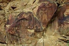Petroglyps στο βράχο μύθου Στοκ Εικόνα