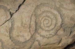 Petrogyph av en spiral, från Knowth Royaltyfri Foto